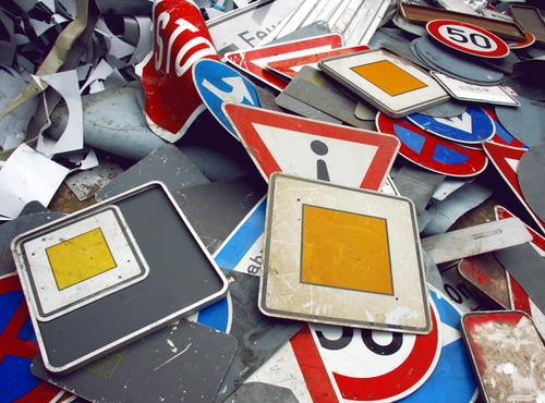obsolete signs lying around Road sign Traffic signs Yield sign Signs and labeling Signage havoc Scrap metal Collection Road traffic Traffic infrastructure Arrow