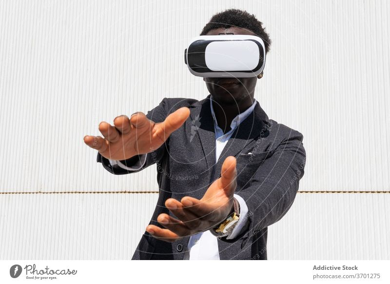 Black businessman in VR headset virtual reality vr using goggles male ethnic black african american innovation digital simulate cyberspace modern glasses device