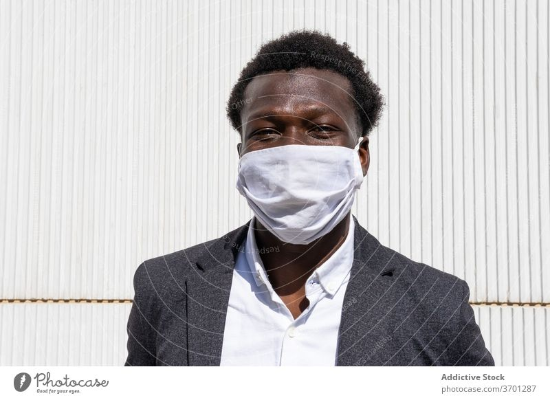 Cheerful black businessman in protective mask coronavirus pandemic covid cheerful entrepreneur formal portrait positive street young african american ethnic