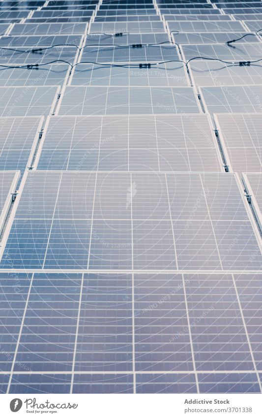 Solar panels at modern factory solar battery contemporary renewal energy resource alternative sustainable environment development plant area industrial ecology