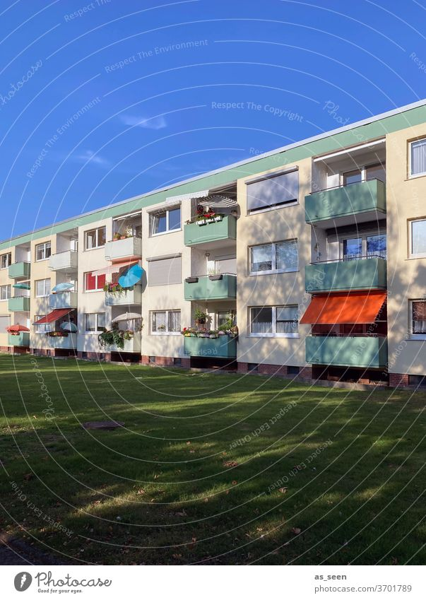 Vacation on Balconies Sunshade Architecture fifties public housing House (Residential Structure) Facade built Town Balcony Colour photo Window Day Deserted