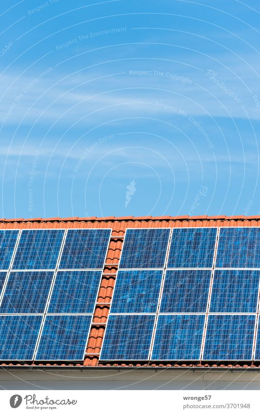 Close-up of a solar plant on a red tiled roof under a blue sky Solar system Solar Power Solar Energy Photovoltaic systems Solar cells electricity Colour photo