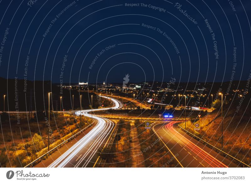 Car light trails in the city of Toledo. Creative night photography no people long highway traffic abstract speed transportation motion blur dusk fast urban