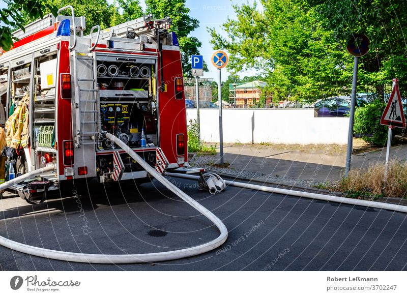 Berlin, 08.06.2018 a fire engine with a lot of equipment Fire engine hose firefighting equipment fire fighting equipment respirator fire safety fireproof sky