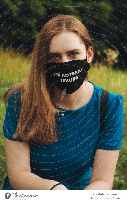 woman with mask outdoors with text i am actually smiling casual concept corona mask corona virus coronavirus covid-19 culture education everyday healthy holding