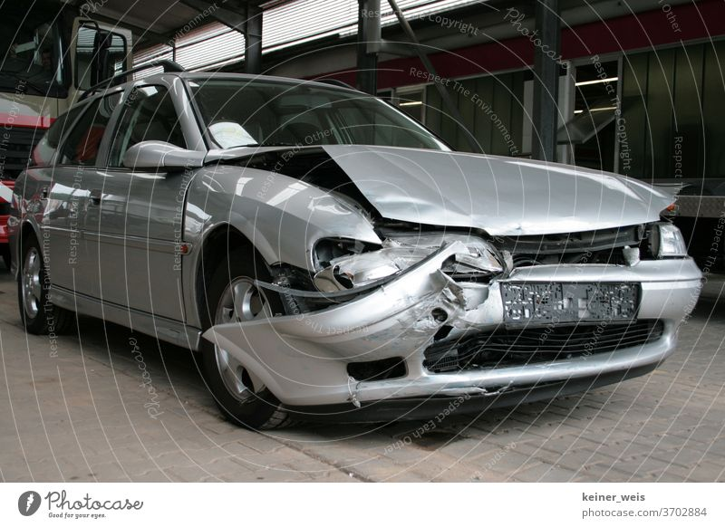 Silver-grey accident car after traffic accident with total loss Car involved in an accident Car accident Total loss Traffic accident Accidental damage