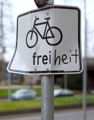 Ride a bike! Signs and labeling Bicycle Symbols and metaphors Day warped Alternative Environmental protection Transport Exterior shot Signage Road sign Street