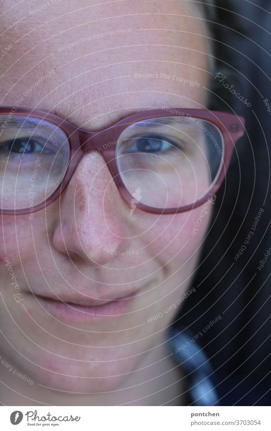 Close-up of the face of a friendly smiling woman with glasses Face Woman smile kind cheerful Adults portrait Looking Feminine natural Authentic brunette