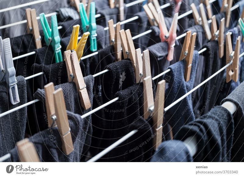 Dark socks - black, grey and blue stockings hang with clothes pegs to dry on the clothes horse Stockings Laundry Holder clothespin Cotheshorse Black Gray Blue