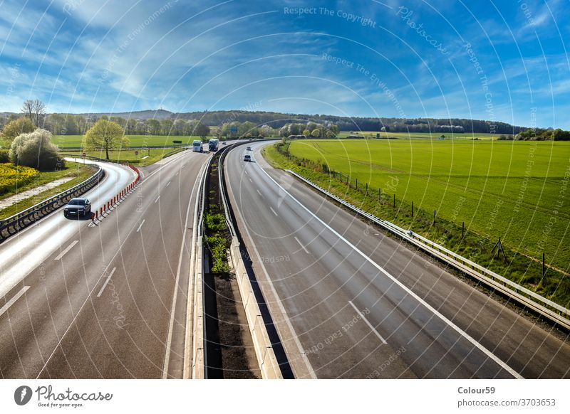 Autobahn landscape germany highway travel speed vehicle car road traffic motion asphalt transport motorway autobahn drive sky freeway street transportation