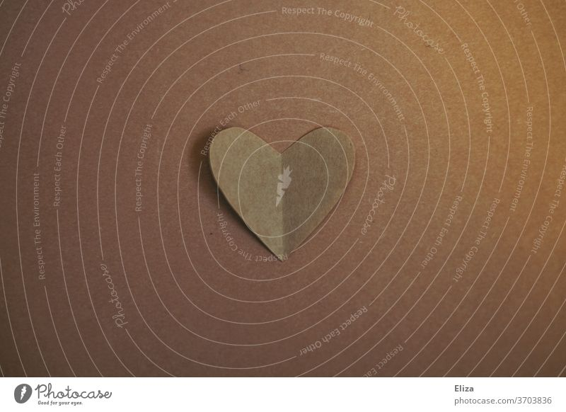 Heart of light brown paper. Tone in tone. Paper tone-in-tone Harmonious matching Decent Love Tone-on-tone Brown Subdued colour Subtle unobtrusively Emotions