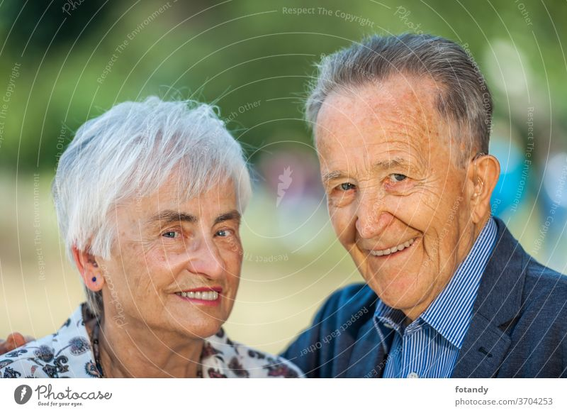 Nice couple of pensioners Married couple Adult Spring Life Portrait Pensioner Senior outside side by side older Happy together green Caucasian cheerful smile
