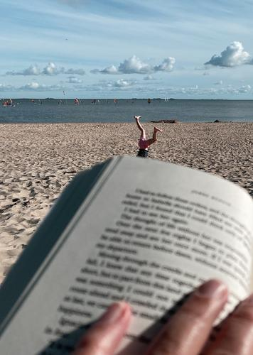 Opposites | rest and exercise on the beach... Beach Reading vacation turn wheels Beach life tranquillity Child Gymnastics North Sea beach Relaxation Book Sand