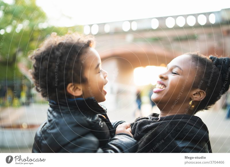 African american mother with his son. single mother monoparental park happy boy people black family smiling child together 20s woman fun love women person