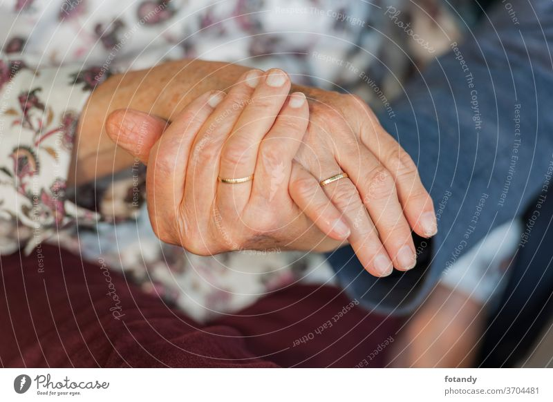 Hands of an 80 year old married couple 80 years old Retirement Married couple Wedding ring Gold ring Ring Adult Life Pensioner Seniors older together Caucasian