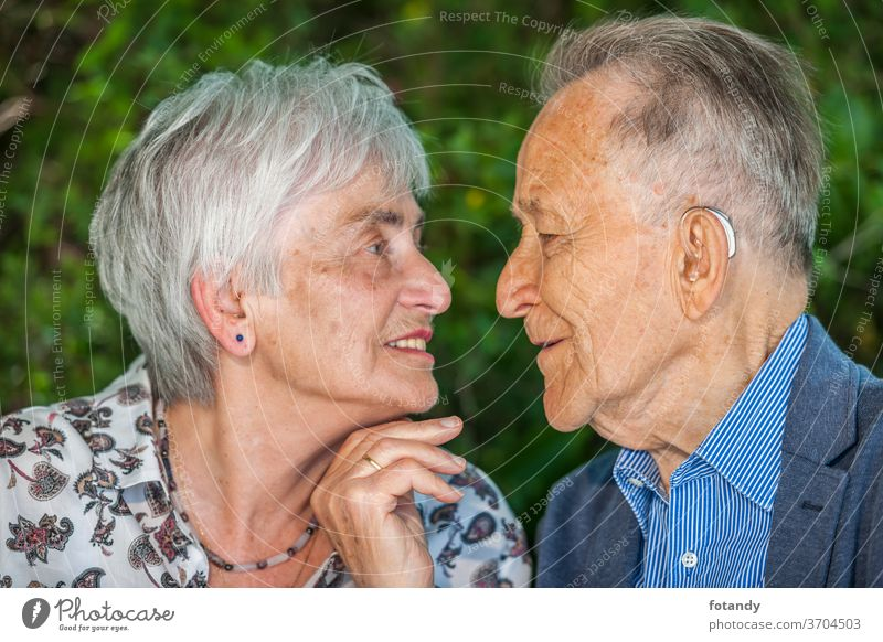 Retired couple shortly before a kiss Kiss Tenderness Person Luck married 80 years old Relationship Park Intimacy charming Partner Closeness side by side