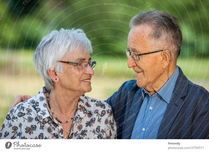 Retired couple in love Married couple Spouses 80 years old loving Jacket Blouse Glasses Glasses wearers Face to Face healthy Life path Retirement Familiarity