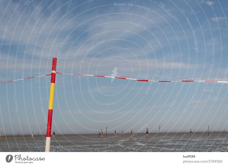 Bars in the mudflats with flutter band - bathing area poles Marker line Mud flats Swimming pool guarded beach Beach North Sea Water Sand Sun Sky Low tide Ocean