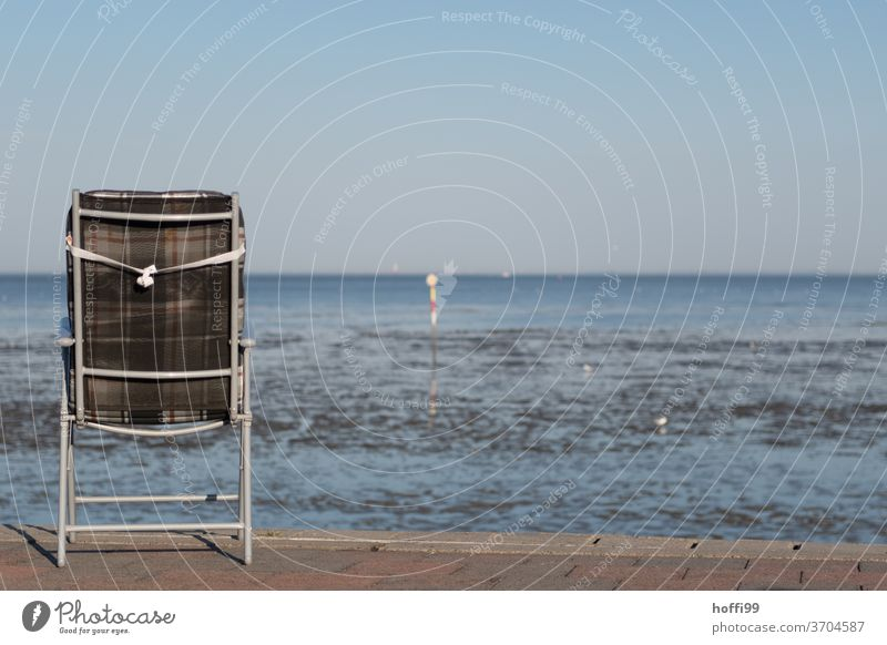 the chair with a view of the sea at high and low tide Chair chairs Idyll Camping chair Camping site Folding chair Minimalistic Beach Summer Lakeside North Sea