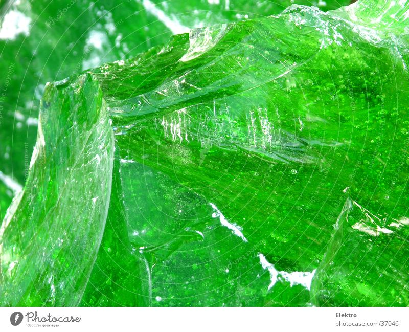 Glass splinter Glass for recycling Glass blower Glazier Fragment Splinter Green Transparent Lamp Lighting Recycling Glimmer Glittering Fiber optics Tactics