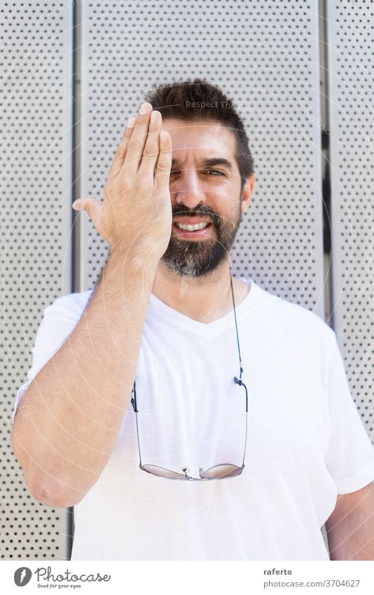 Bearded man with sunglasses gesturing while looking at camera portrait 1 male person young surfer adult casual attire outdoors wall tongue beard bearded happy
