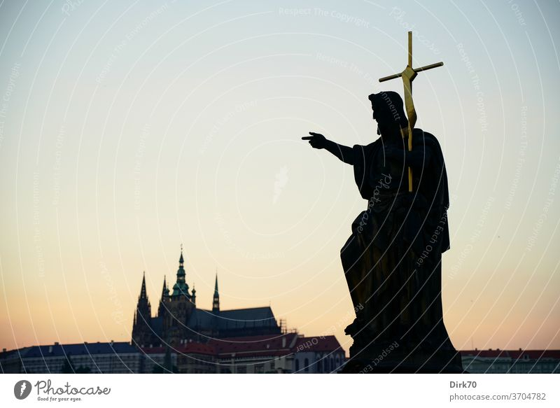 Statue on the Charles Bridge with St. Vitus Cathedral in the background Sculpture Symbols and metaphors Crucifix Christian cross more christian believe