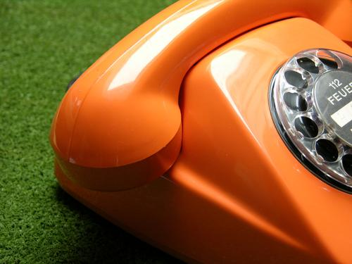 in a good mood Telephone Rotary dial Receiver Telecommunications Communicate Blaze Fire Orange Green Compromise Access network Electrical equipment Technology