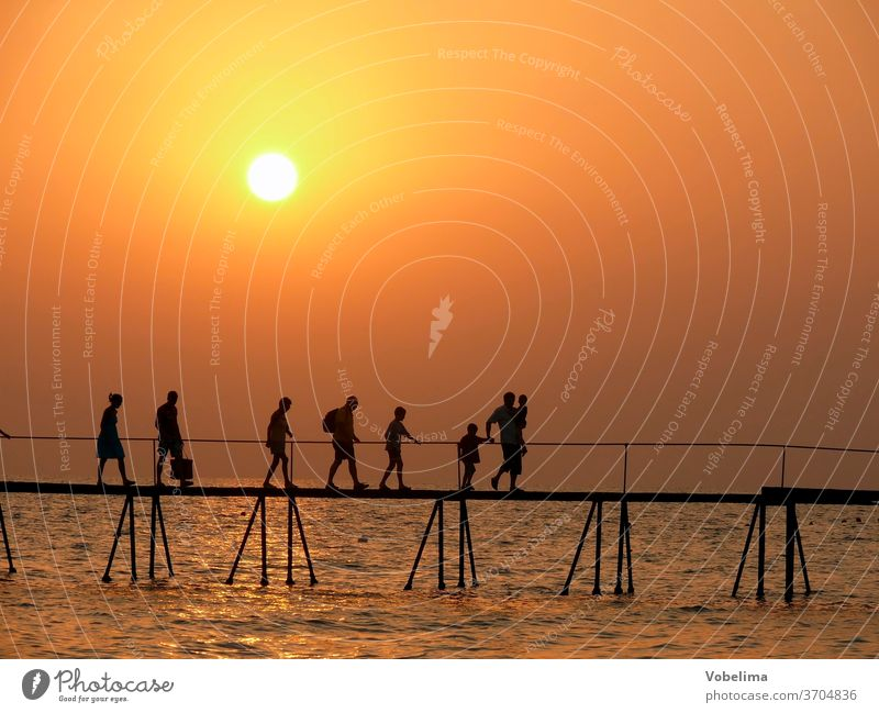 People on a jetty, in the evening side turkey Turkish Riviera Sunset Evening bridge Group group person persons Ocean Water ocean evening sky evening mood Beach