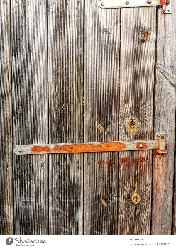 Old wooden door with metal lock Goal locked Closed Entrance Front door Door handle Lock Structures and shapes Wooden door Safety Wooden gate Main gate cast-iron