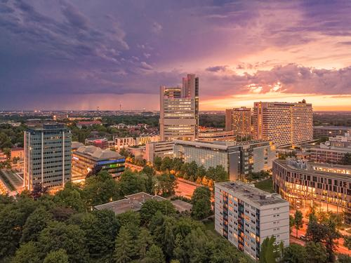 Munich from above, a panoramic droneshot in the colorful evening. high angle sunset office architecture life modern beauty shot typical urban aerial amazing