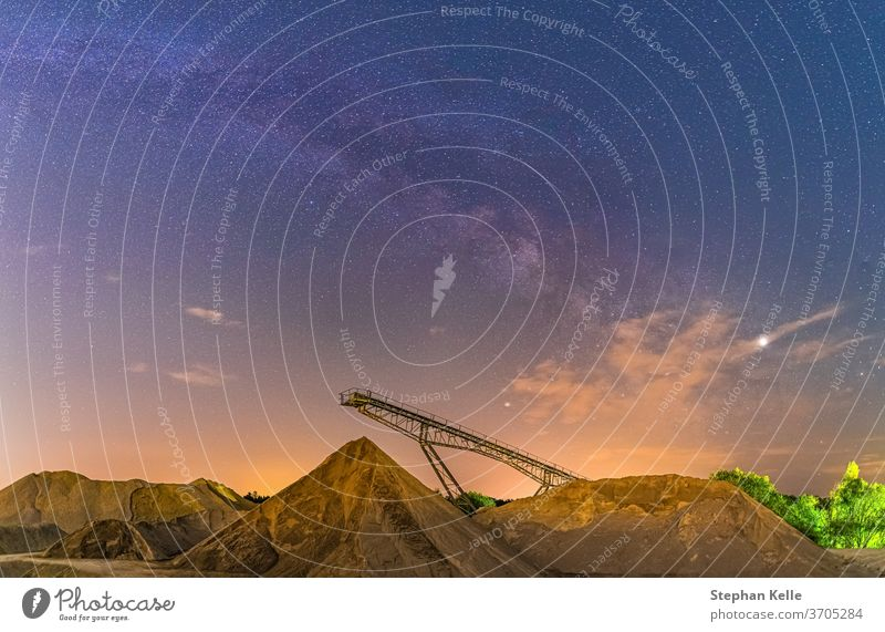 Conveyor bridge at night and Milky Way, observation of the stars on a construction site. Milky way Construction Astrophotography Conveyor belt background Stars