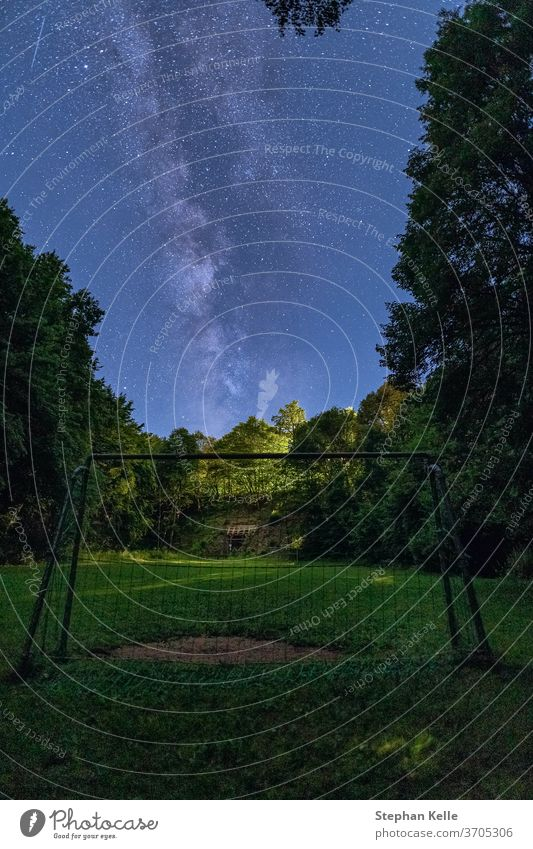 The Milky Way rises over a goal in the foreground. milkyway night sky star space nobody trees starry grass landscape galaxy constellation nature free universe