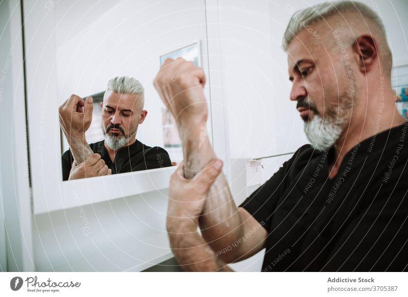 Crop man washing hands in sink hygiene soap water bathroom routine foam male clean wet liquid skin care body treat fresh pure guy stand splash clear relax