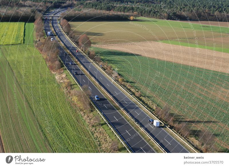 Landscape with two-lane federal road as aerial photograph Federal highway Street two lanes Transport cars Motor vehicle lorry Traffic infrastructure lorries