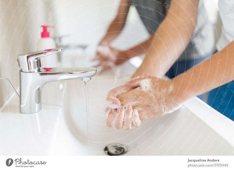 two men washing hands during the Corona pandemic Washing hands hygiene coronavirus covid-19 Healthy Soap Sink double washbasins Water Tap Virus Protection COVID