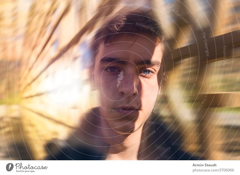 Portrait of a serious young man with dynamic background portrait beautiful handsome speed motion blur sunlight flare lines perspective powerful confident