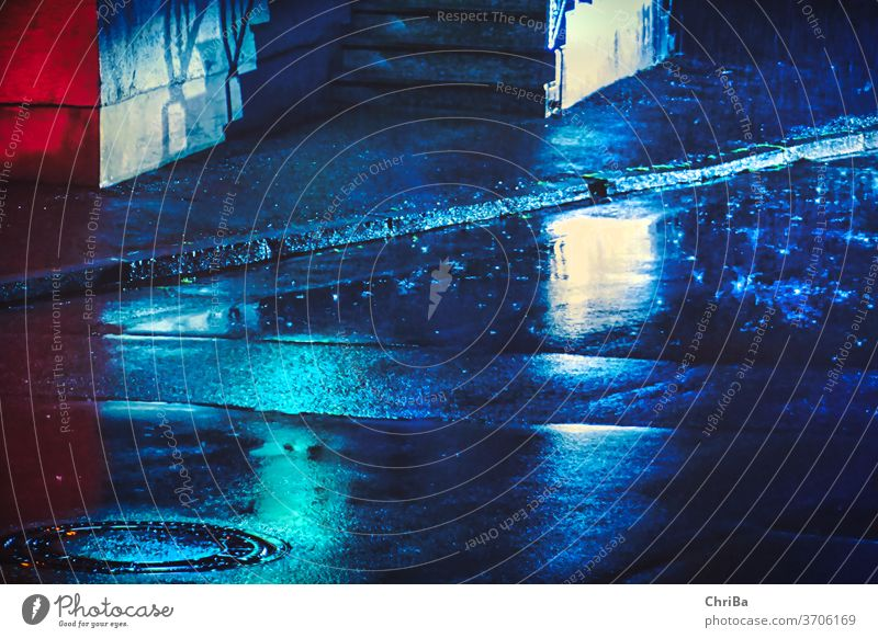 Street at night in the rain with blue lighting manhole cover Rain Evening Night rainy colors Neon light Street lighting citylights urban urban olive Light