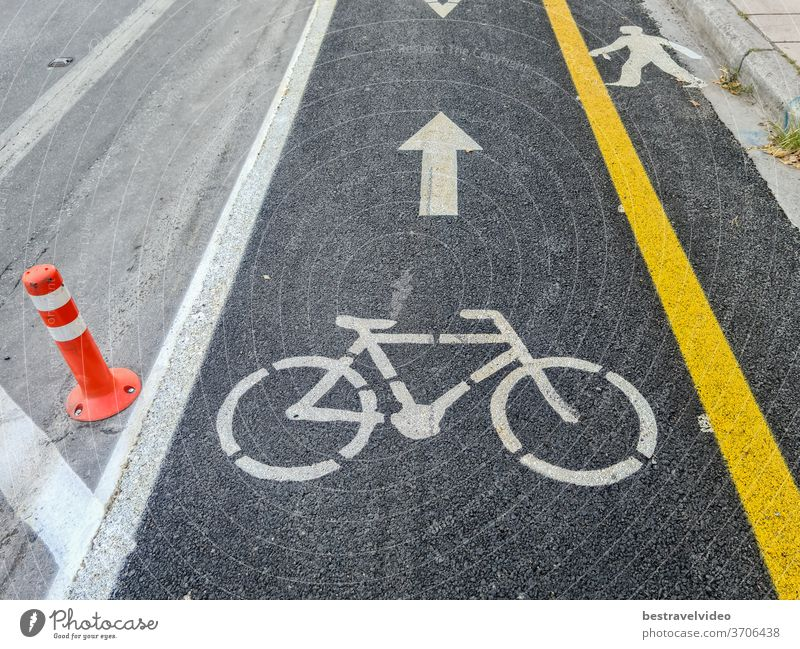 New urban transport bikeway with yellow separation line next to an asphalt road. Traffic only allowed to bicycles at marked bike path along the cycling infrastructure in Thessaloniki, Greece.