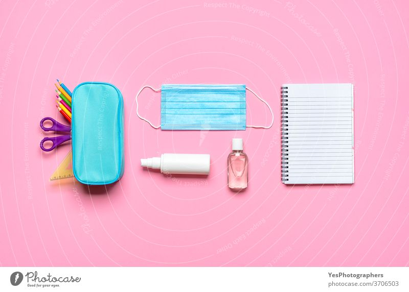 School supplies on a pink desk. Back to school pandemic requirements back back to school background blank blue concept corona covid covid19 creative layout