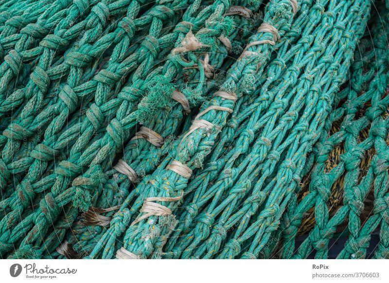 Detail of a trawl net on a pier. Fishing net Net fishnet Fisherman fishing weave craft tangle Rope rope little story scam Lake Ocean High sea Deep-sea fishermen