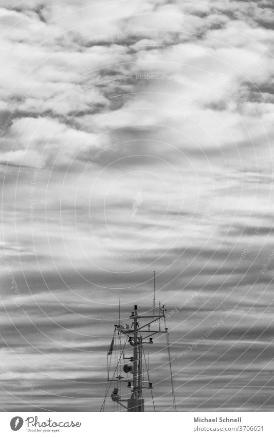 Mast of a fishing boat in front of a cloudy sky at the North Sea ship Exterior shot Black & white photo Clouds Clouds in the sky Black and white Fishing boat