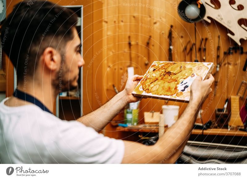 Luthier working with lacquer in workshop luthier prepare repair artisan mix varnish restore man craft skill master male maker occupation handmade fabricate