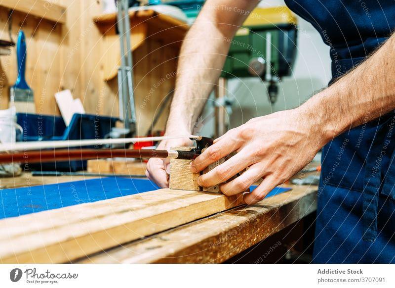 Luthier restoring violin bow in workshop luthier repair make artisan instrument restore man craft tool wooden equipment skill master male hand maker occupation