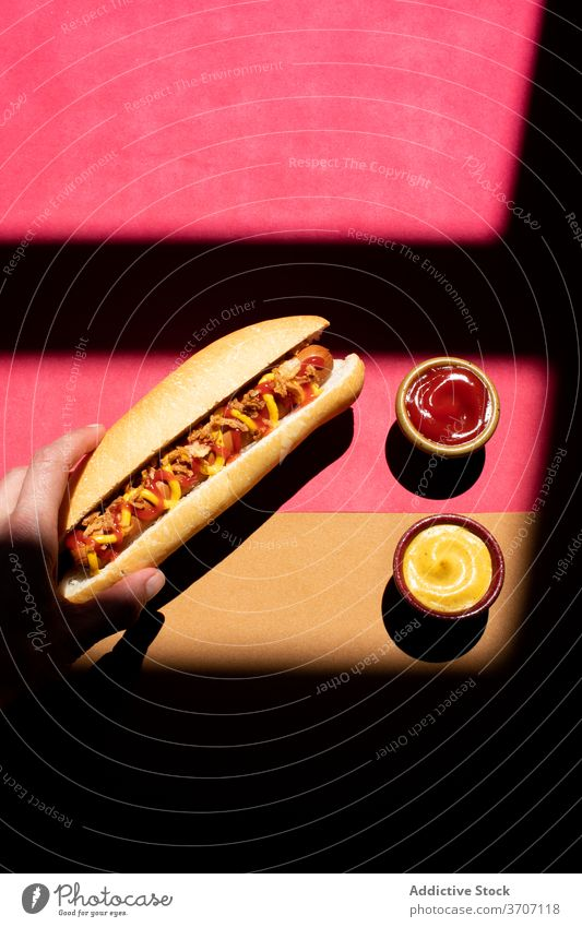 Frankfurt hot dog with mustard and ketchup closeup culinary zigzag sandwich weiner background frankfurter sausage snack lunch bun american food dinner grilled