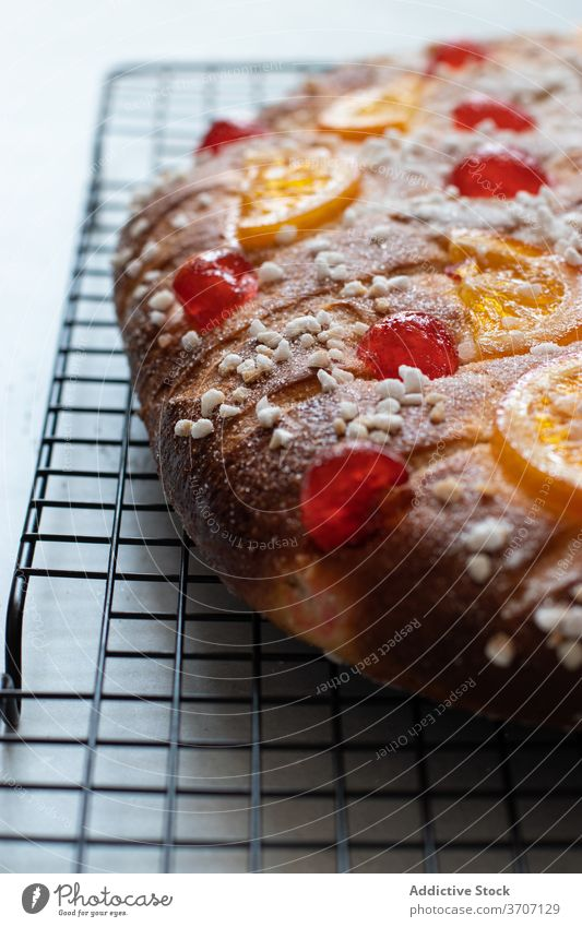 Coca de San Juan cake decorated with orange and cheery traditional cake traditional bakery cherry fruit pine nuts custard recipe baked cava gastronomy