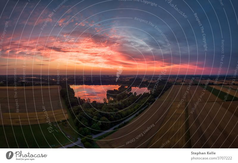 Aerial panorama of the countryside landscape with a beautiful sunrise in the early summer morning. lake environment sunlight field background nature tree water