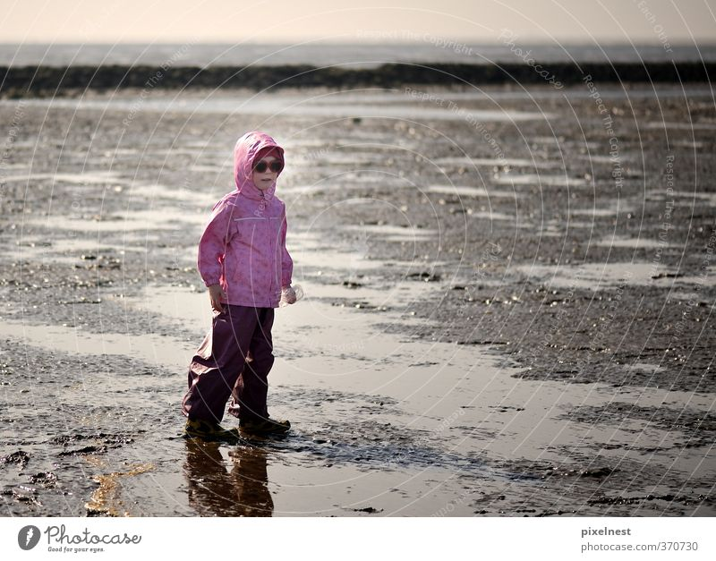 Girl in the wad Playing Vacation & Travel Far-off places Summer Summer vacation Sun Beach Ocean 1 Human being 3 - 8 years Child Infancy Sand Water Clouds