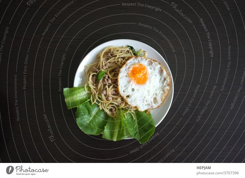 Spaghetti stir fried with Thai Basil spicy sauce with Fried egg  , fusion Thai style asia asian background basil closeup cooking cuisine delicious dinner dish
