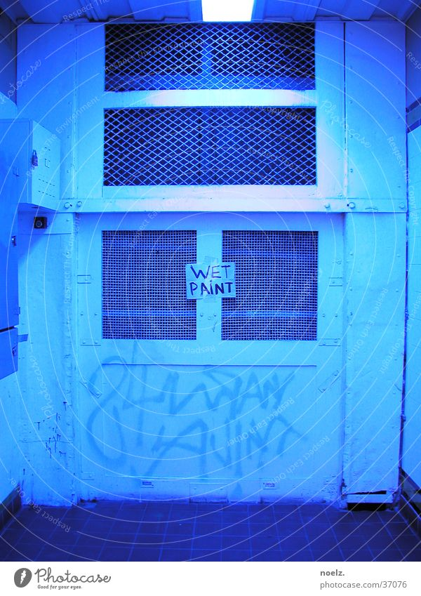DOOR WET PAINT. Light Hut Dim Canceled Photographic technology Door Blue graffiti wet paint nailed blue light Colour
