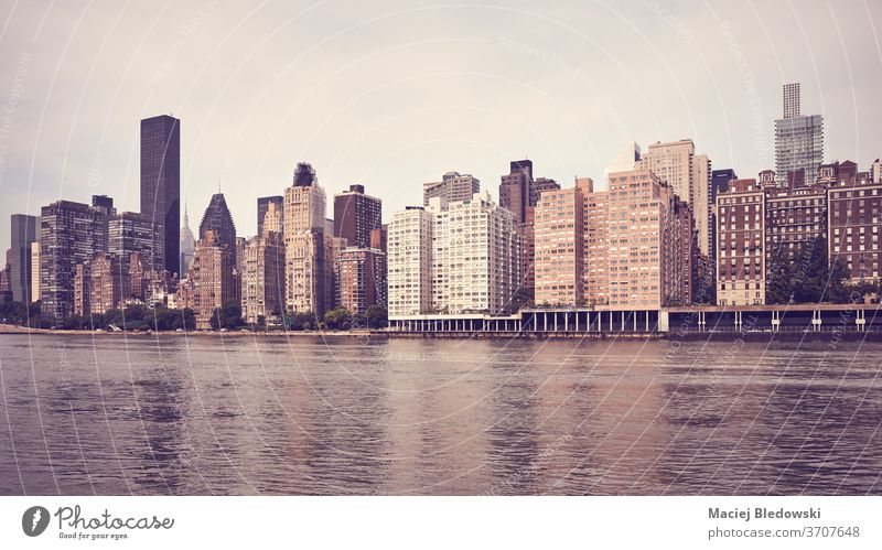 Vintage toned picture of New York East Side waterfront, USA. usa skyscraper city panoramic skyline retro filtered building cityscape york urban town Manhattan